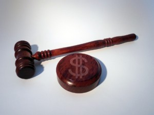 Gavel and sound block with a dollar sign signifying saving with automated time and attendance